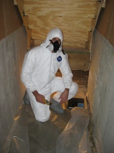 Michael suited up and ready to inspect for mold in a dark, scary crawl space